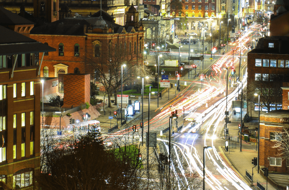 Elevated view of Leeds City Centre at night.