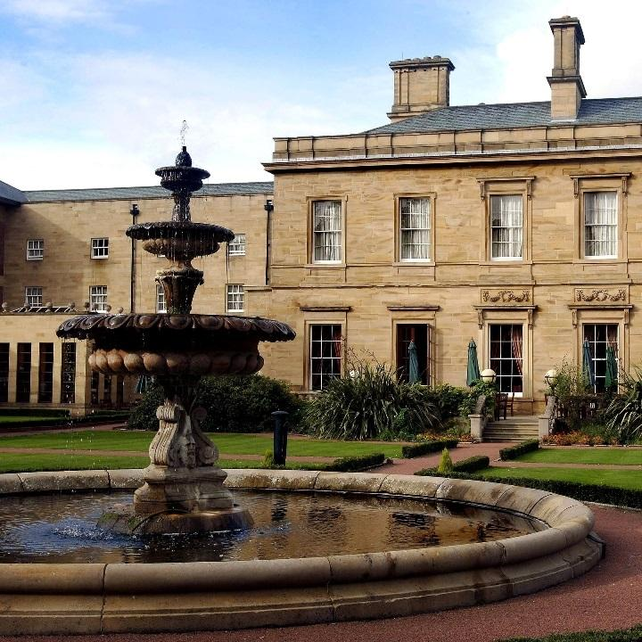 External daytime view of Oulton Hall with fountain in the foreground.
