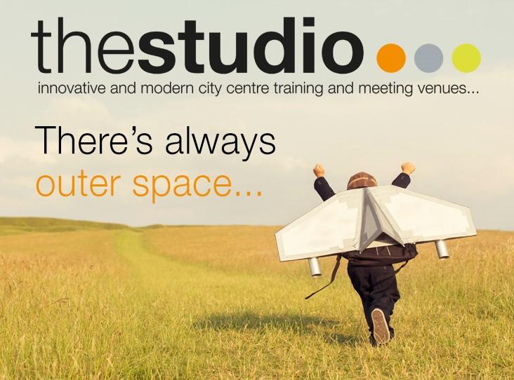 studio outside space man dressed as an aeroplane in field