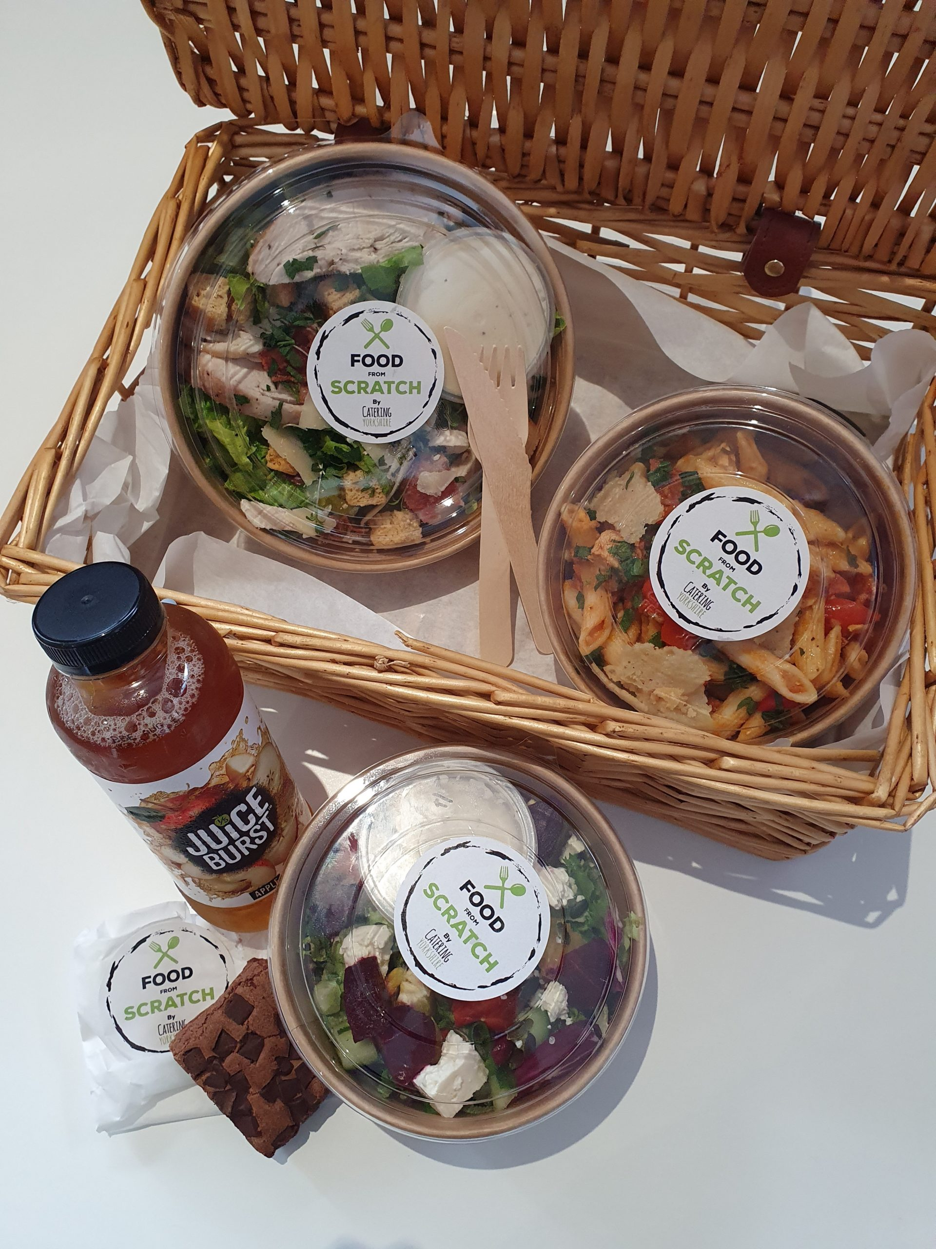 Examples of picnic food offered by Horizon in basket with salads, pastas etc